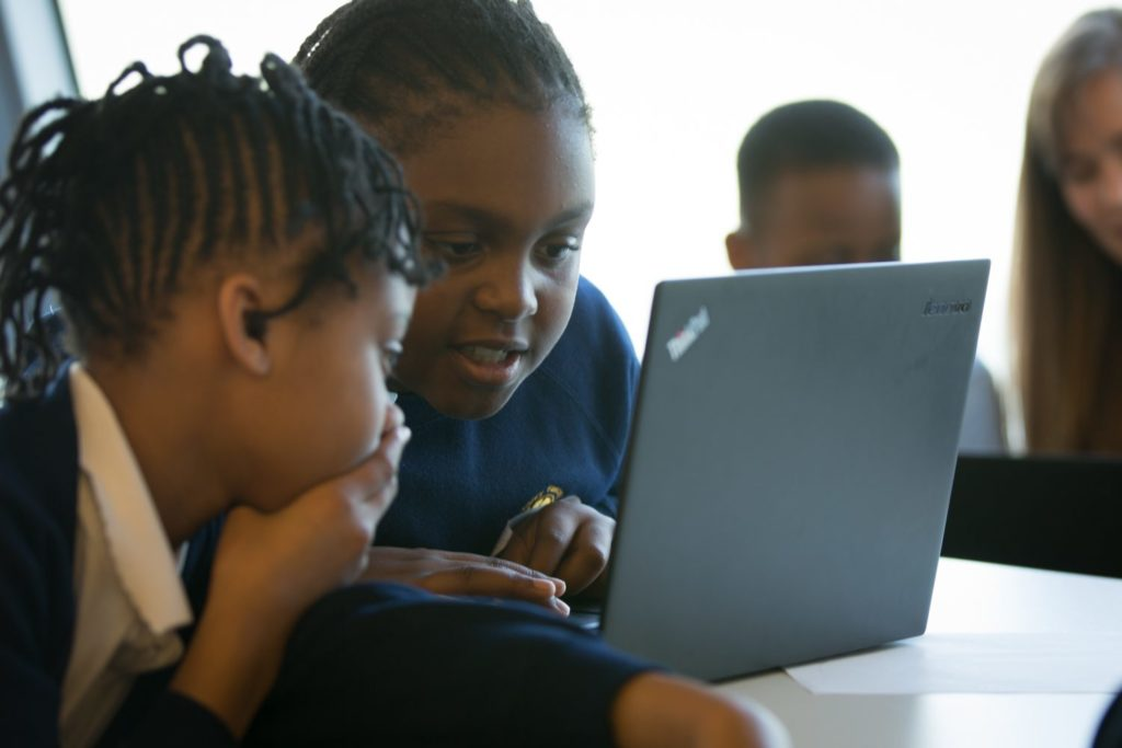 Children looking at a screen